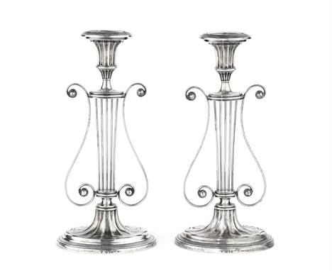 A pair of silver candlesticksEllis Jacob Greenberg, London 1928 Lyre form, with filled oval bases and reeded borders, height