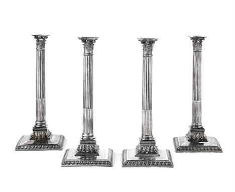 A set of four George III silver candlesticksEdward Wakelin, London 1756 Corinthian column form, with removable drip-pans, fil