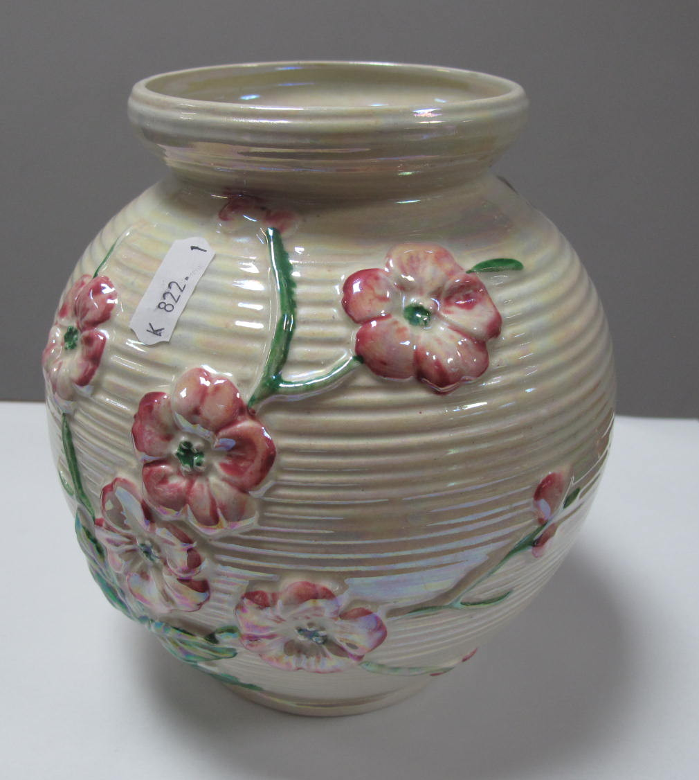 Lot 10 - Maling Pottery Globular Vase, with floral decoration on ribbed pearl lustre ground, 16.5cm high.