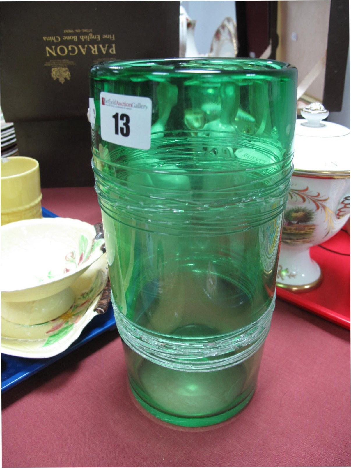 Lot 13 - A Leerdam Green Glass Cylinder Vase, with two entwined bands, ground pontil, makers name and date