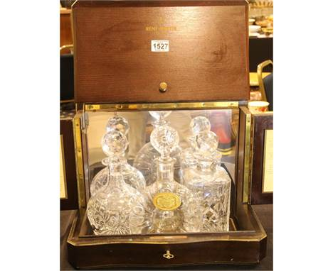 Remy Martin cognac tantalus box with Remy Martin Baccarat crystal glass decanter and two further decanters. Not available for