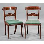 Suite of Four American Late Classical Carved Mahogany Side Chairs , mid-19th c., scrolled crest