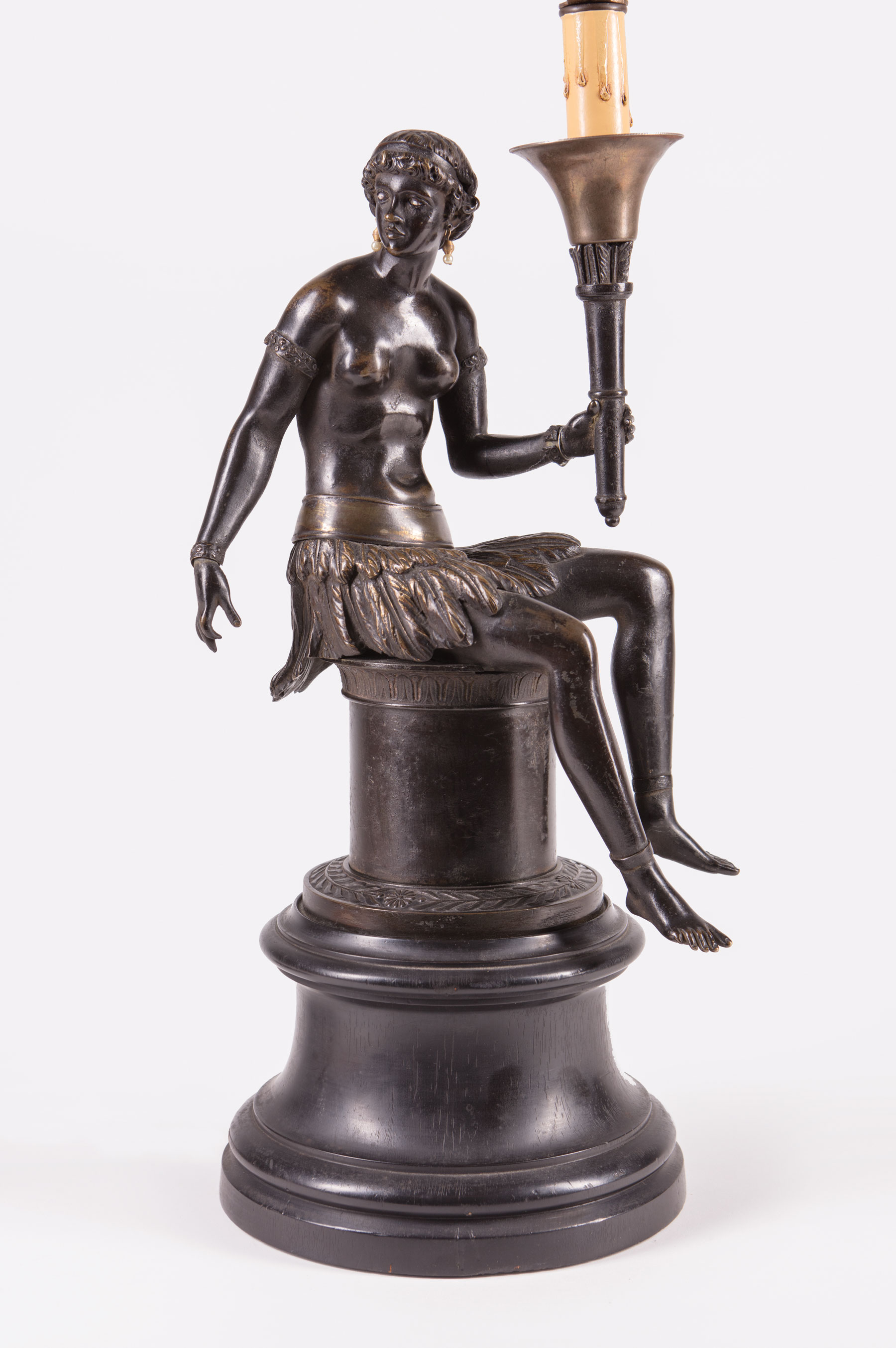 """Lot 79 - French Patinated Bronze """"Bon Sauvage"""" Figure , 19th c., figure holding a quiver, with pearl earrings"""