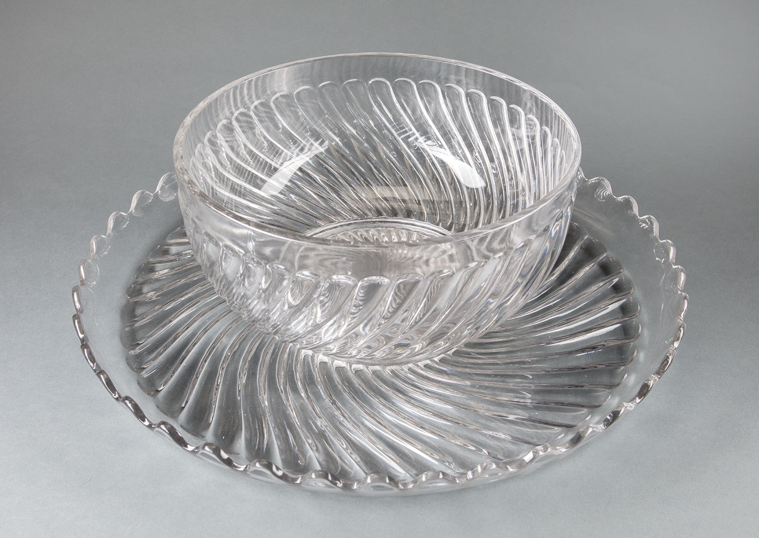 Lot 918 - Antique Baccarat Swirl Motif Molded Crystal Punch Bowl and Undertray , early 20th c., marked, h. 5