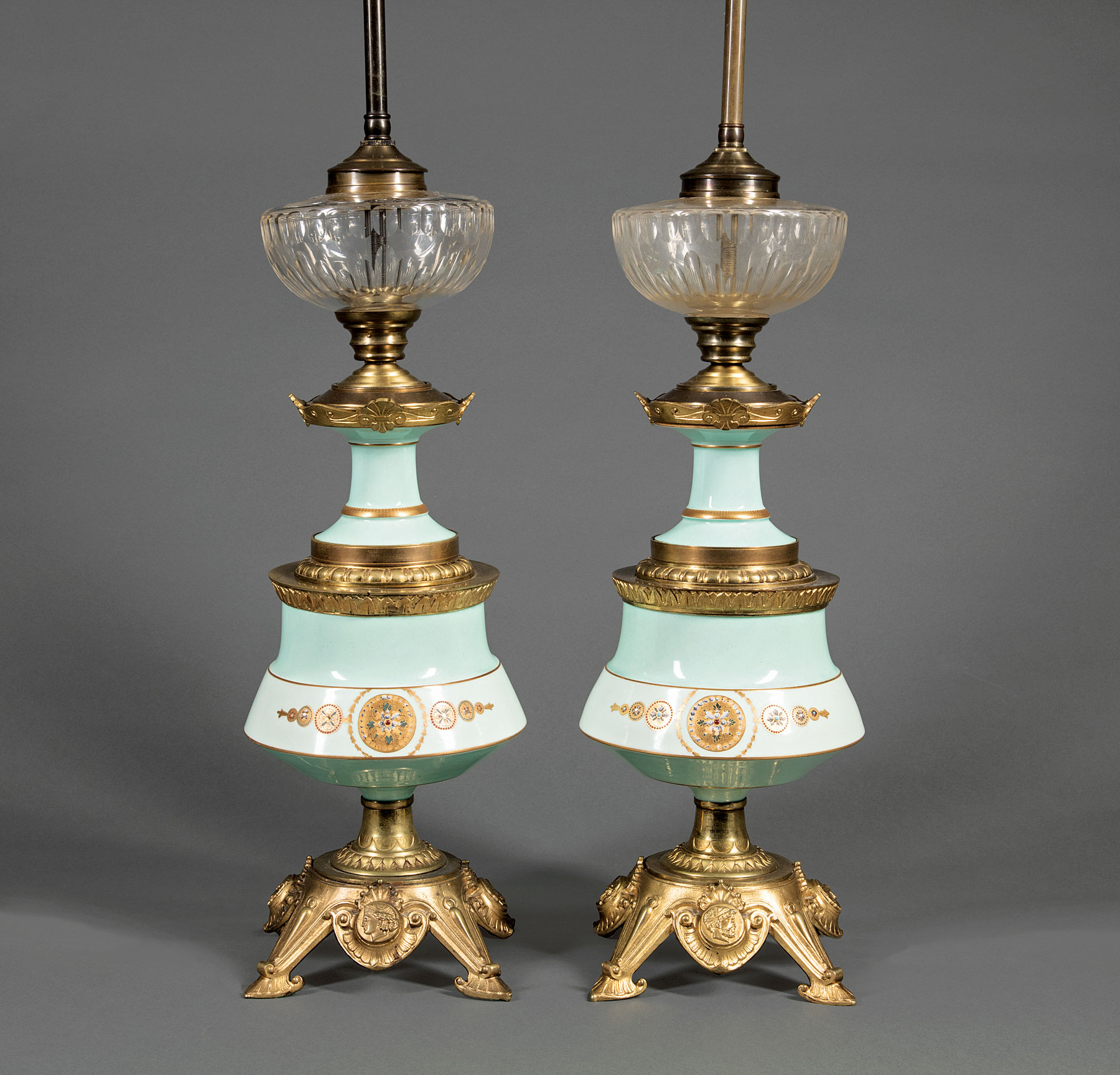Lot 924 - Pair of Napoleon III Bronze-Mounted Porcelain Lamps , in the Renaissance taste, cut glass font, base