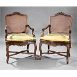 Pair of Antique Provincial Louis XV Carved Walnut Fauteuils , 18th c., diapered shell and scroll