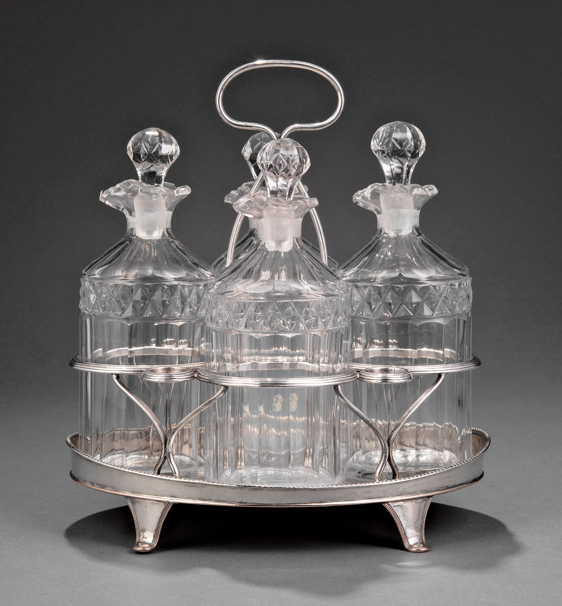 Lot 748 - George III Sheffield Plate Cruet Stand , late 18th c., oval stand with reeded handle, bottle