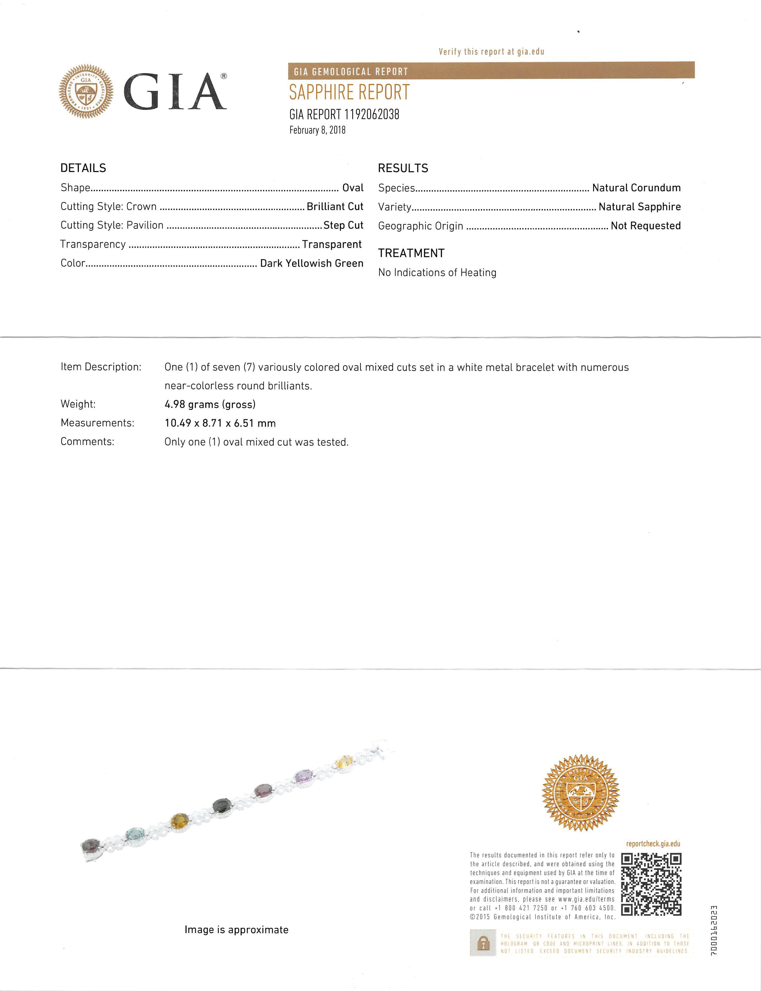 Lot 615 - Rare 14 kt. White Gold, Sapphire and Diamond Bracelet , seven prong set oval mixed cut multicolor