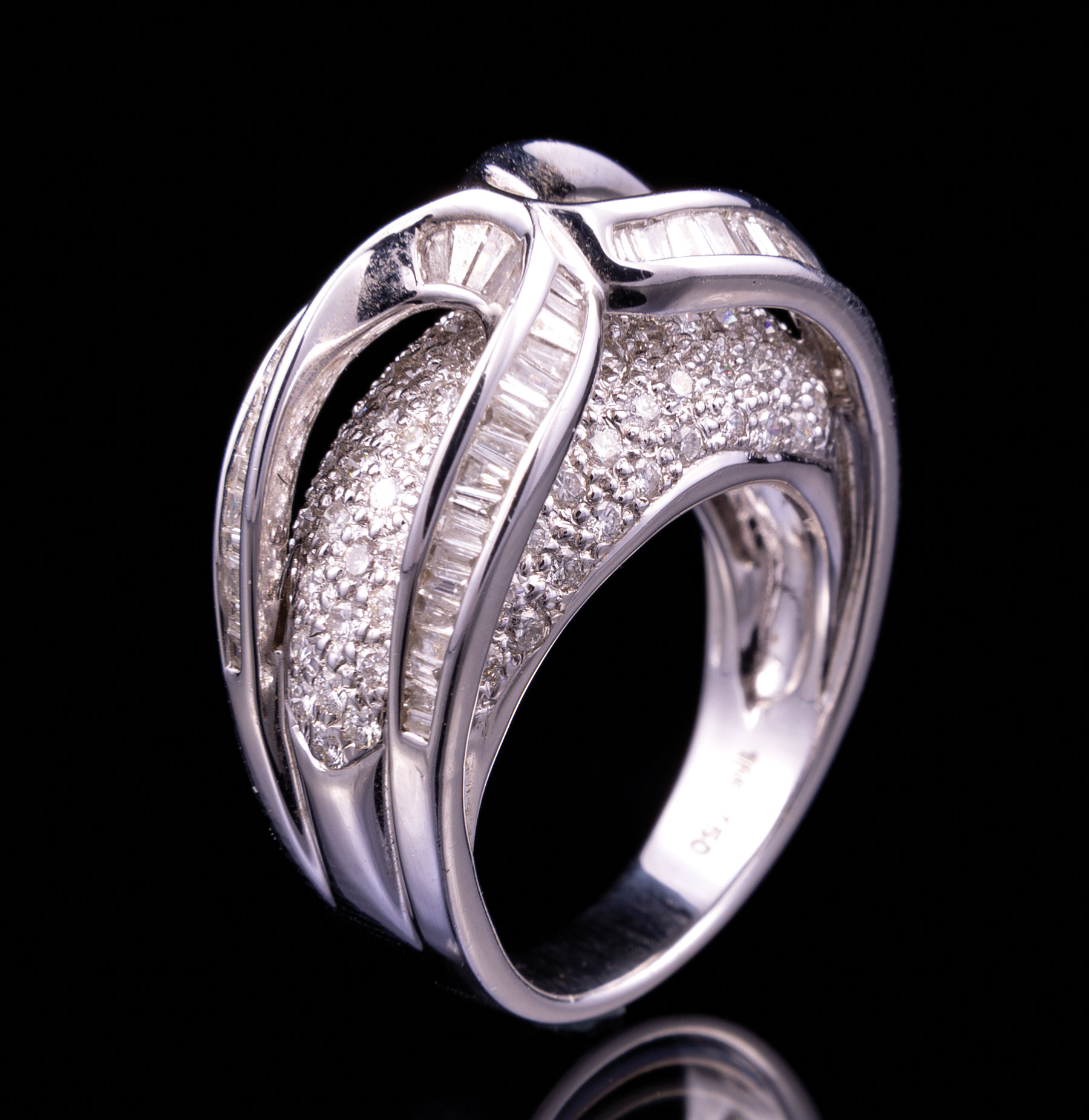 Lot 604 - 18 kt. White Gold and Diamond Ring , 107 pavé set round brilliant cut diamonds, total wt. approx.