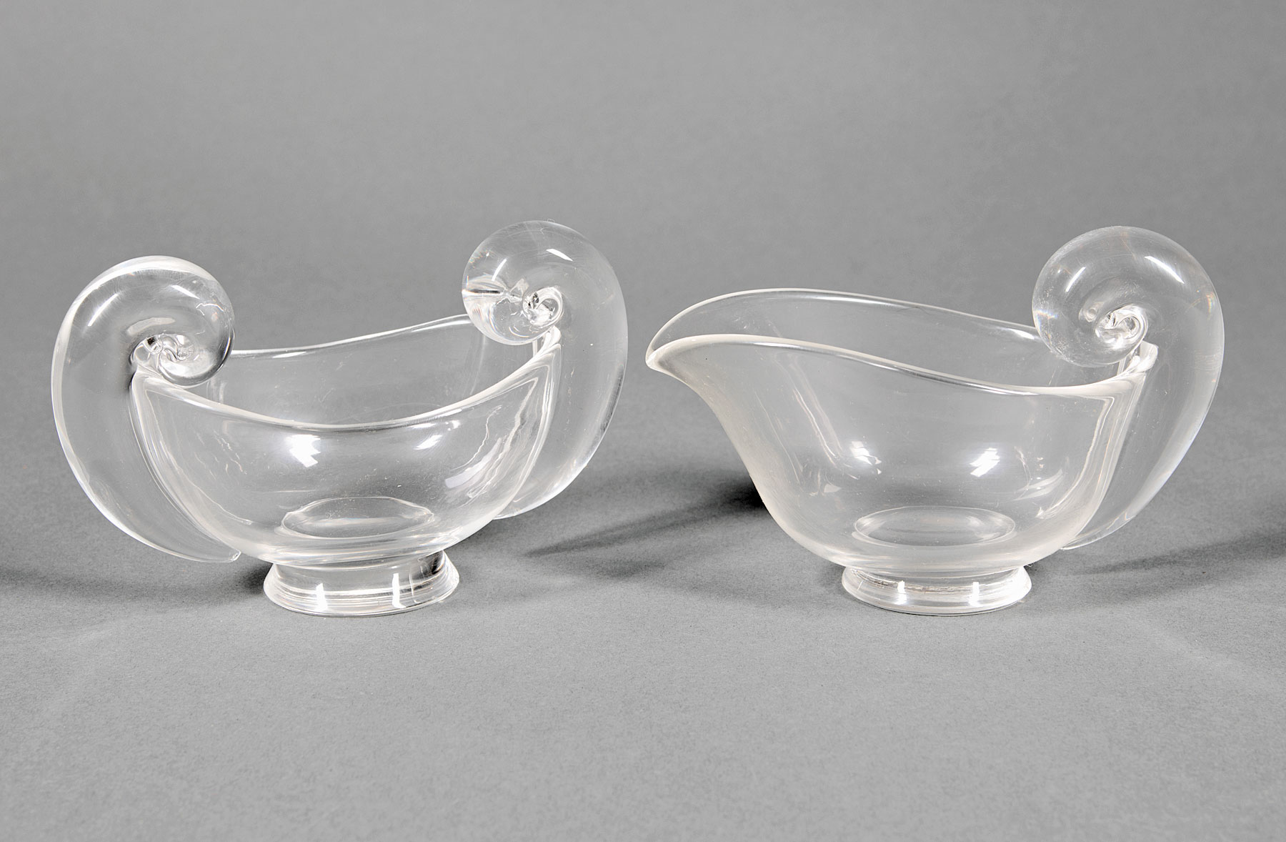 "Lot 989 - Steuben Glass ""Snail-Scroll"" Sugar Bowl and Cream Pitcher , etched marks, models #7941 and #7942,"