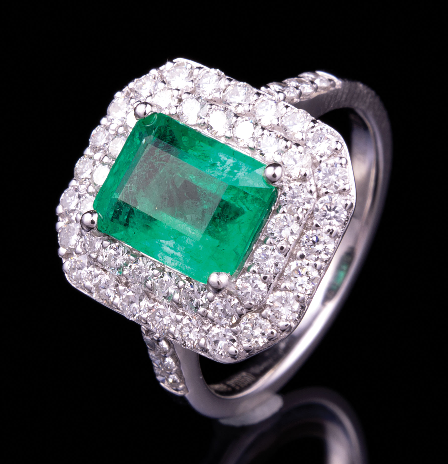 Lot 584 - Platinum, Emerald and Diamond Ring , prong set rectangular step cut natural emerald, 8.80 x 7.00 x