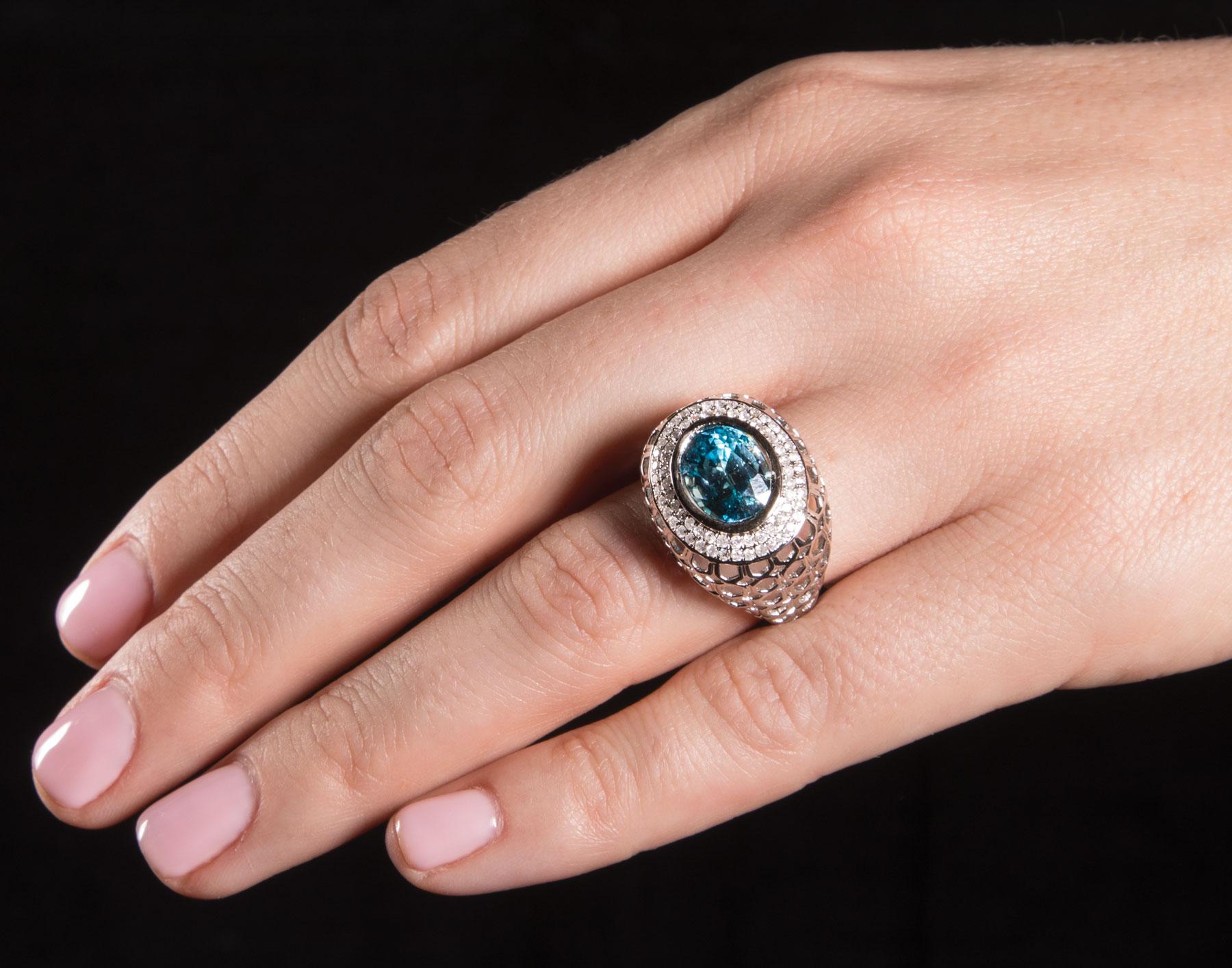 Lot 593 - 14 kt. White Gold, Blue Zircon and Diamond Ring , bezel set oval cut zircon, approx. 11.06 x 8.45