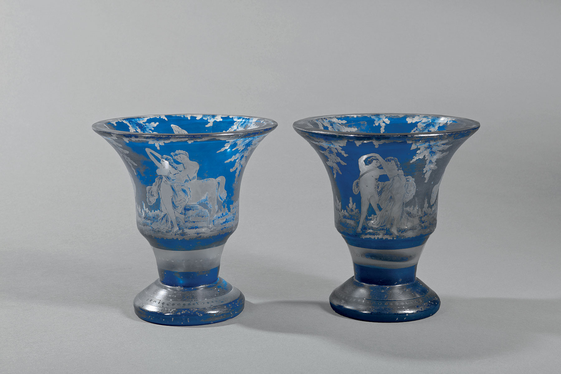 Lot 985 - Pair of Italian Painted Blue Glass Vases , 19th c., reserve-decorated with dancing nudes and