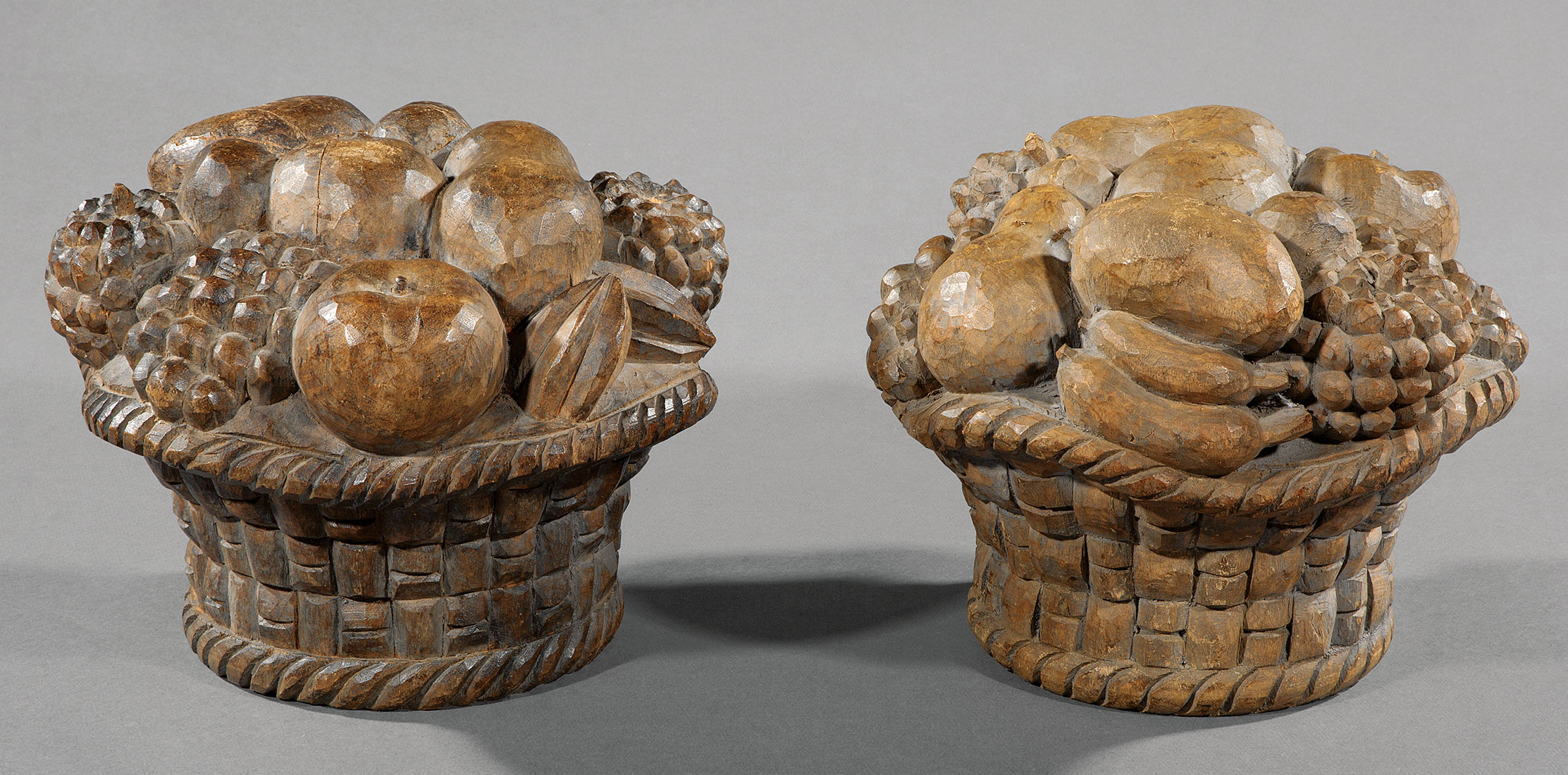 Lot 1084 - Pair of Carved Pine Fruit Baskets , 19th c., h. 9 1/2 in., dia. 11 in