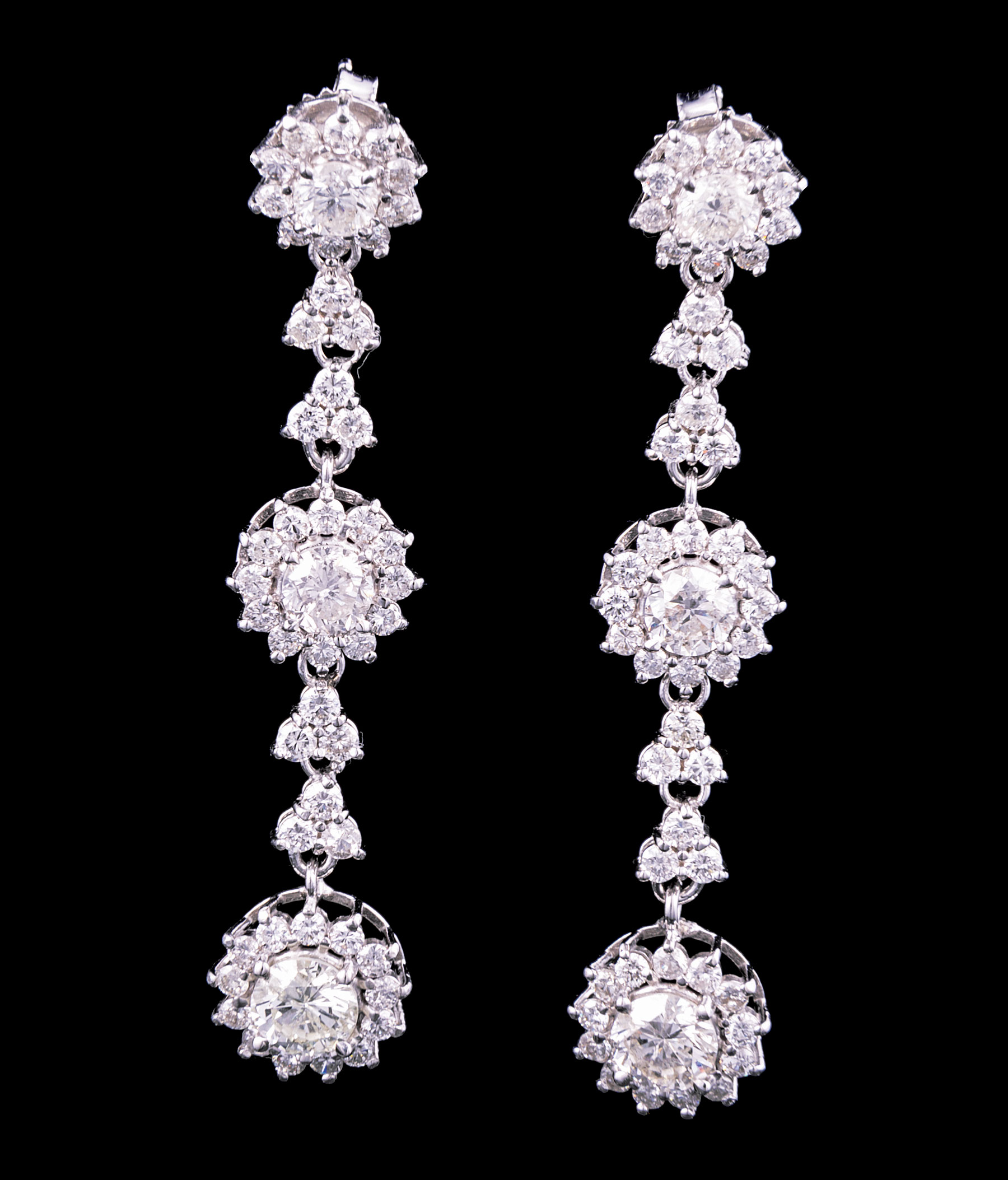 Lot 605 - Pair of 18 kt. White Gold and Diamond Earrings , each set with 3 round diamonds, total wt. 2.79