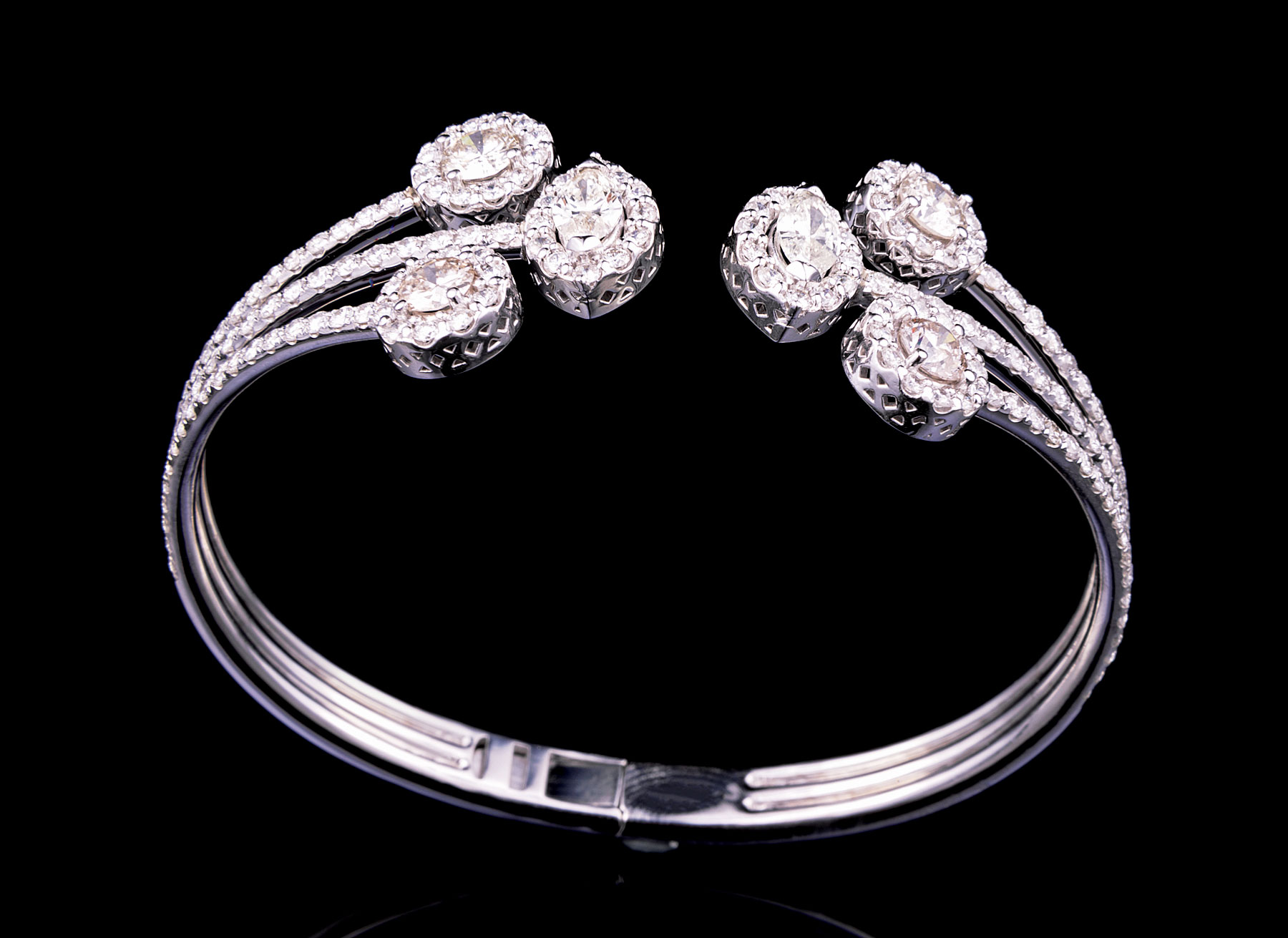 Lot 598 - 18 kt. White Gold and Diamond Cuff/Bangle , 2 marquise cut diamonds and approx. 180 round