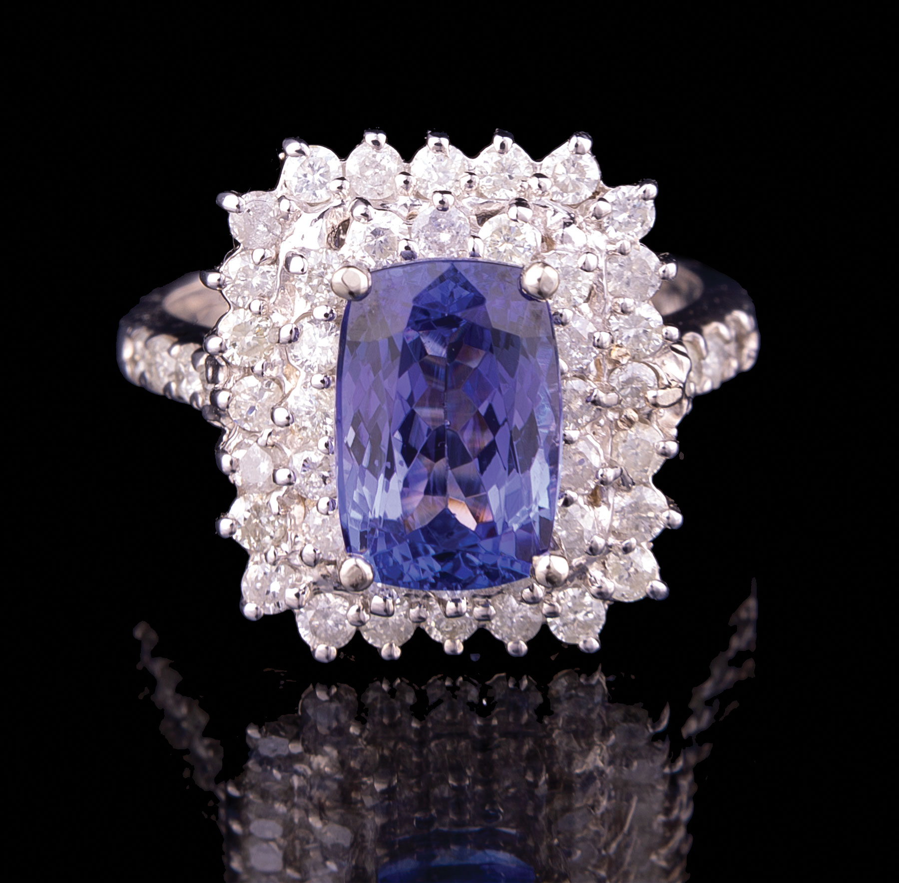 Lot 591 - 14 kt. White Gold, Tanzanite and Diamond Ring , central rectangular faceted tanzanite, wt. 3.07