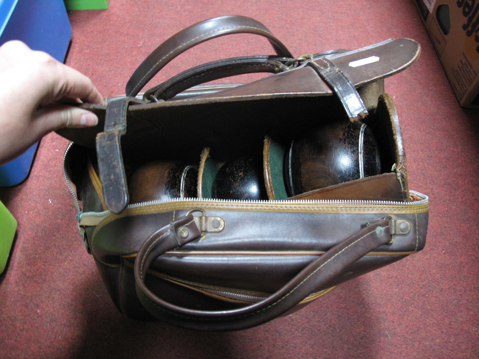 Lot 706 - Two Lignum Vitae Crown Green Bowls and Jack, in fitted leather case; plus two Taylor Elite 2-6