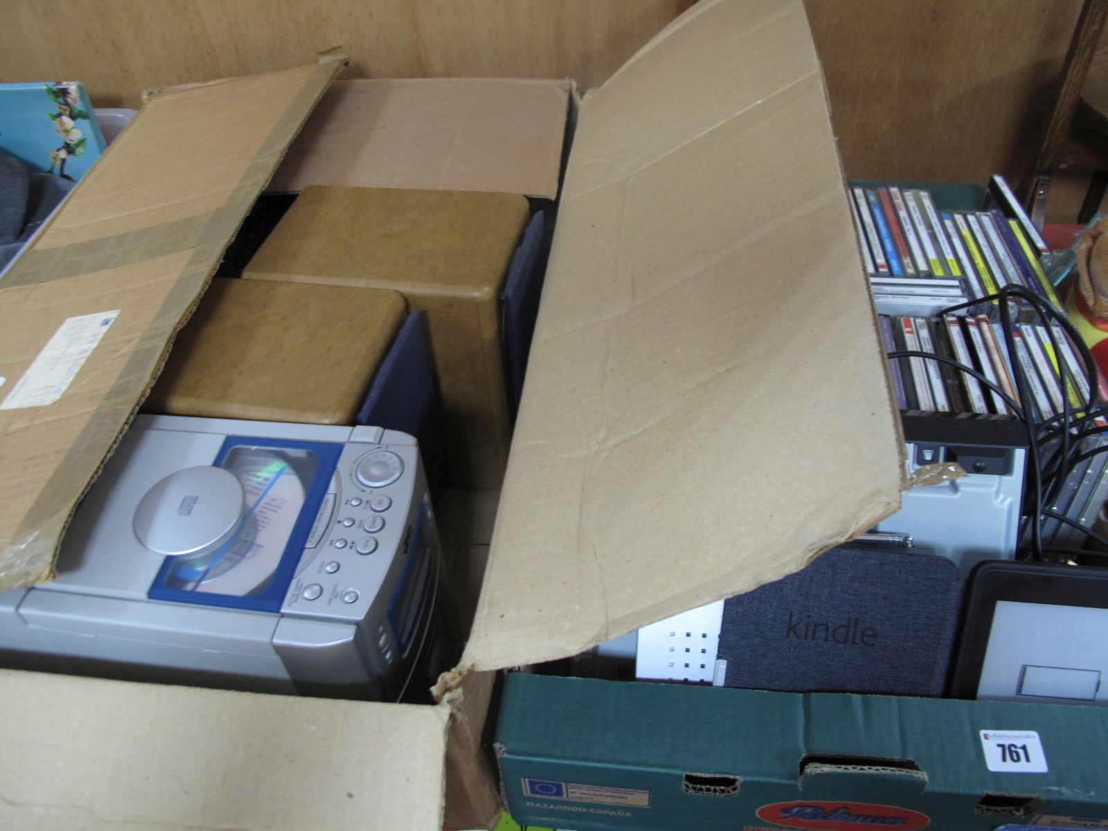 Lot 761 - A Kindle, DVD, radio, JVC CD system, CD's (untested, sold for parts only):- Two Boxes