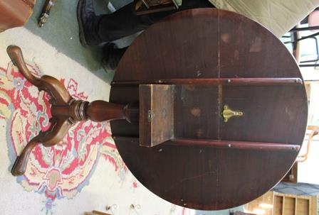 Lot 59 - A 19TH CENTURY MAHOGANY CIRCULAR TILT-TOP TABLE, on baluster turned column and three fancy downswept