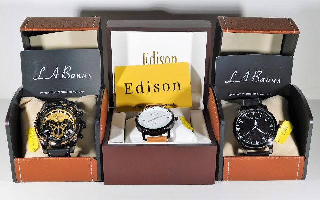 Lot 280 - Three boxed fashion watches, one a/f