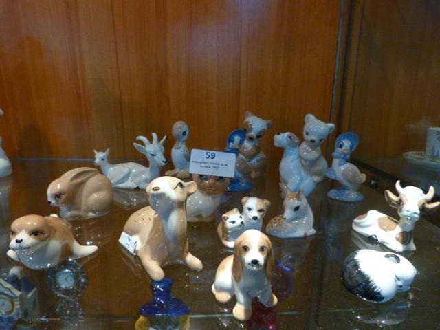 Lot 59 - Seventeen Szeiler Pottery Miniature Figures