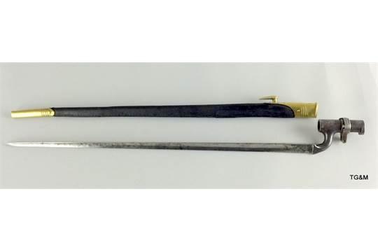 A British Pattern 1853 Enfield socket bayonet in a