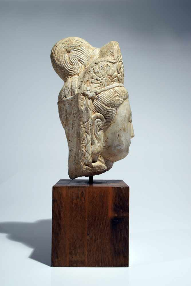 Lot 52 - Head of GuanjinStoneChina12th ctH: 30 cmThis beautifully modeled head of a Guanyin shows the