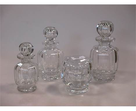 Baccarat, France: a c1940 crystal part dressing table set, of octagonal and faceted form, comprising: three graduated bottles