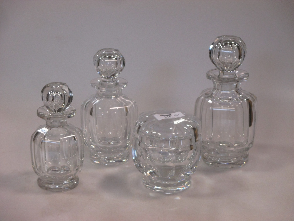 Lot 216 - Baccarat, France: a c1940 crystal part dressing table set, of octagonal and faceted form,