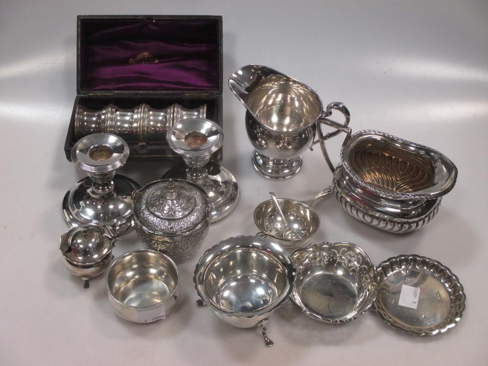 A collection of silver including a cream jug, a tea strainer a pin tray, a mustard, a bonbon dish, a