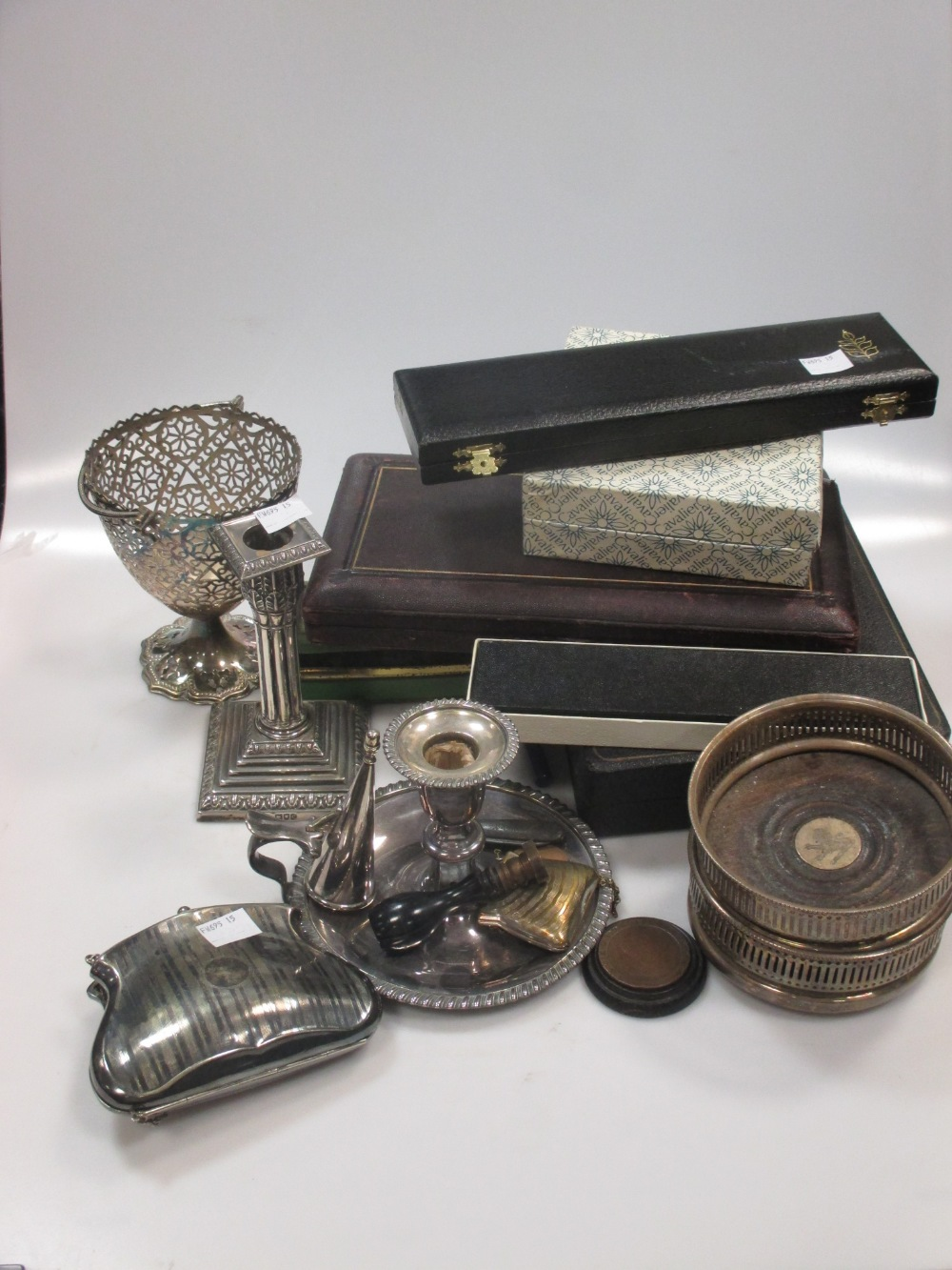 A silver dwarf candlestick, cased teaspoons, pair plated bottle coasters, and various plated items
