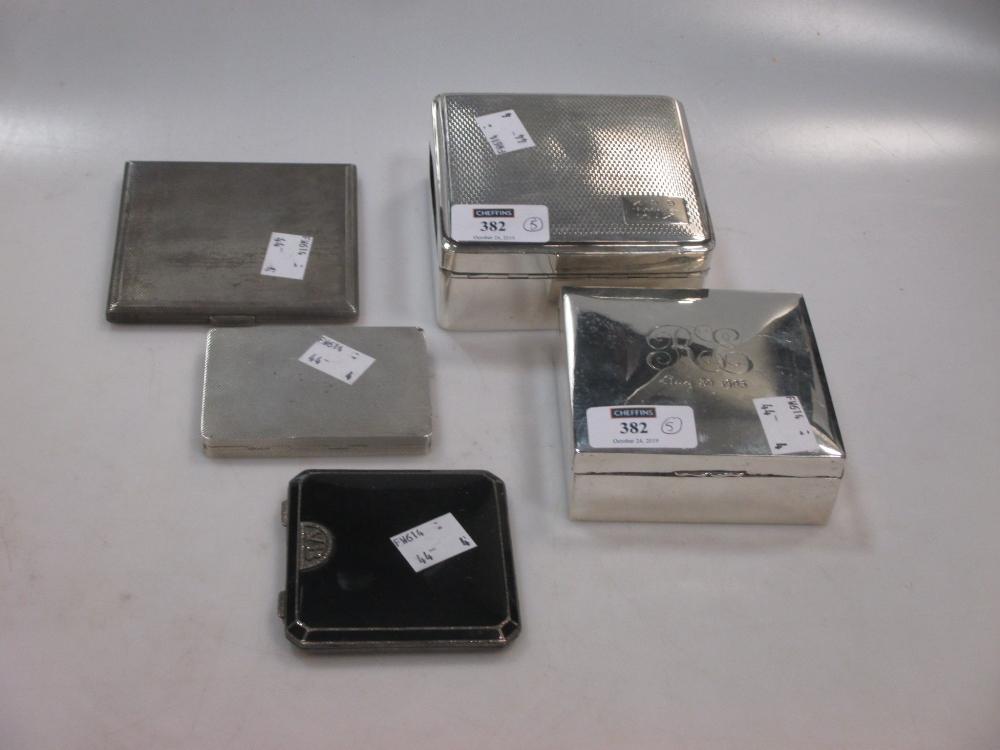 Five silver cigarette boxes