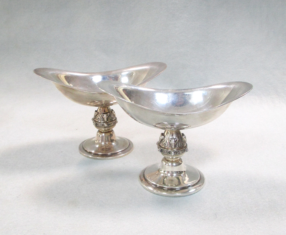 A pair of 20th century silver salts, each of deeply dished navette form and raised on a circular