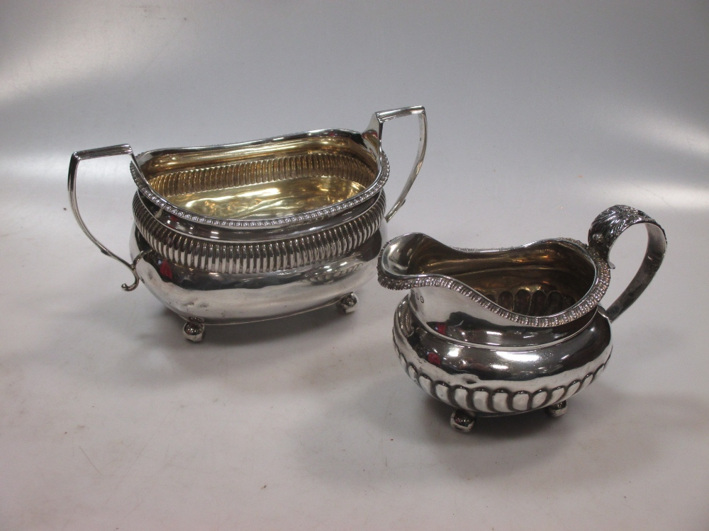 A silver cream jug and a silver sugar bowl 15.4ozt gross (2)