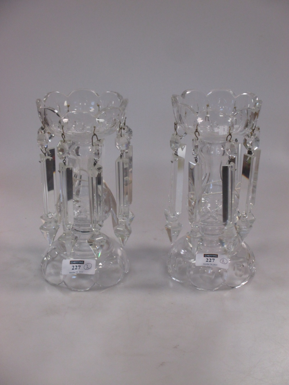 Lot 227 - A pair of cut glass table lustres