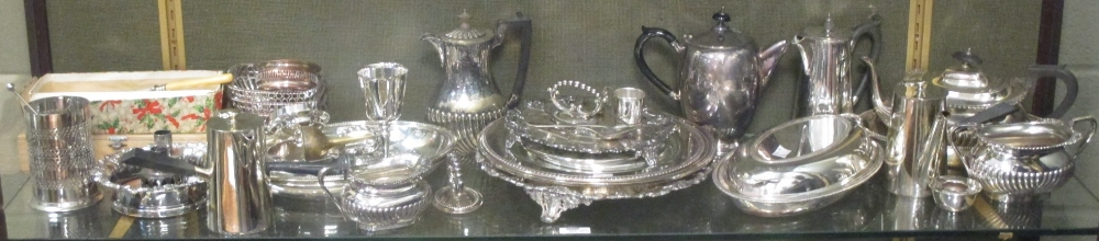A large collection of silver plated ware to include entree dishes, trays, bottle coaster,