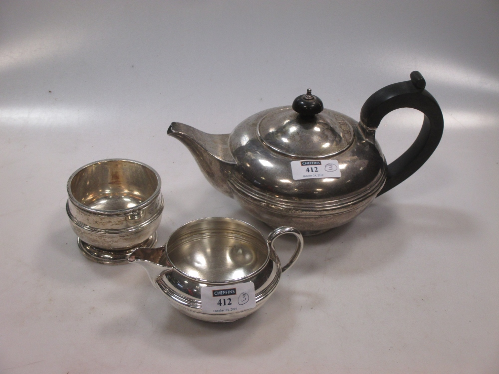 A silver teapot together with a silver milk jug and sugar bowl, 23.9ozt gross (3)