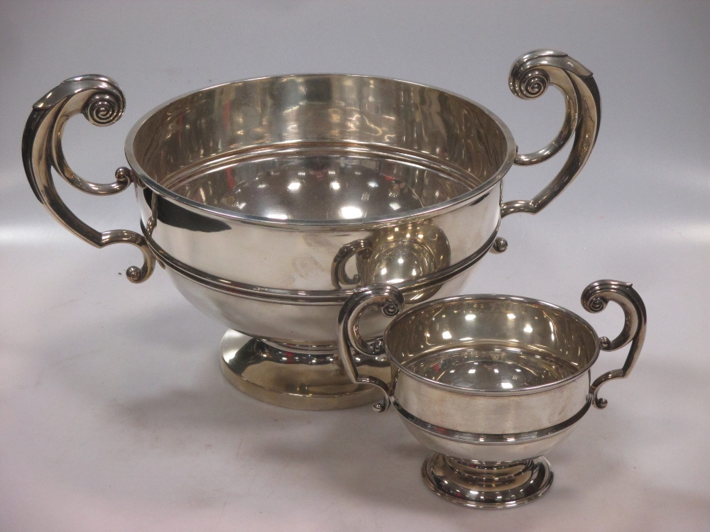 An Edward VII silver two-handled bowl by Walker & Hall, Sheffield, 1905, with scrolling handles,