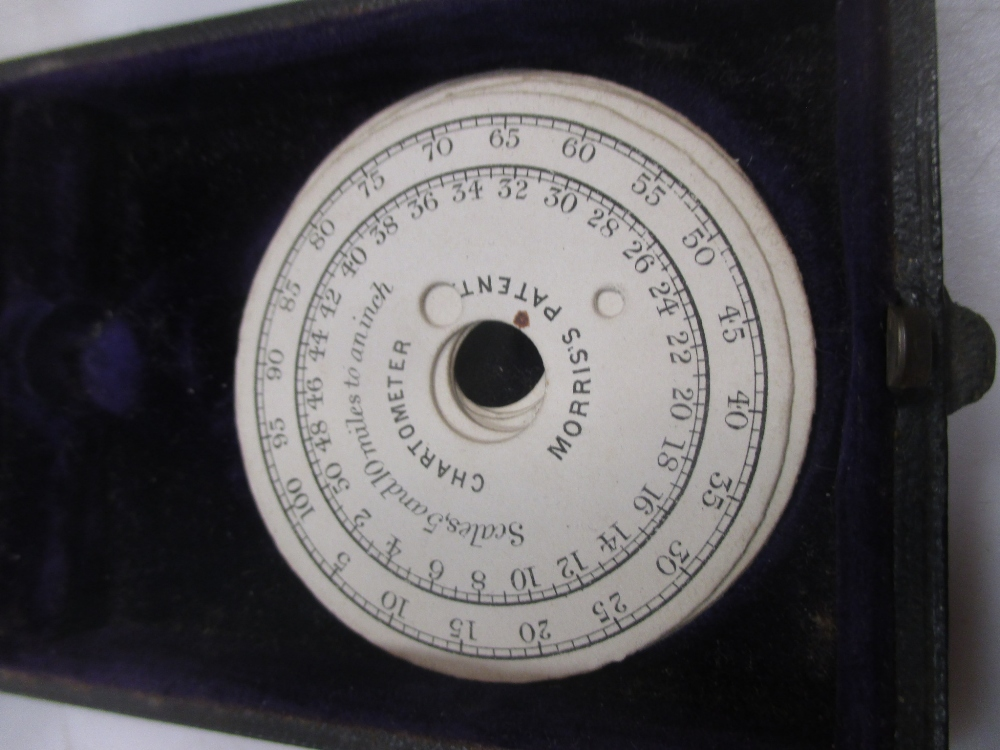 Lot 359 - A Morris patent chartometer, cased, with spare dials