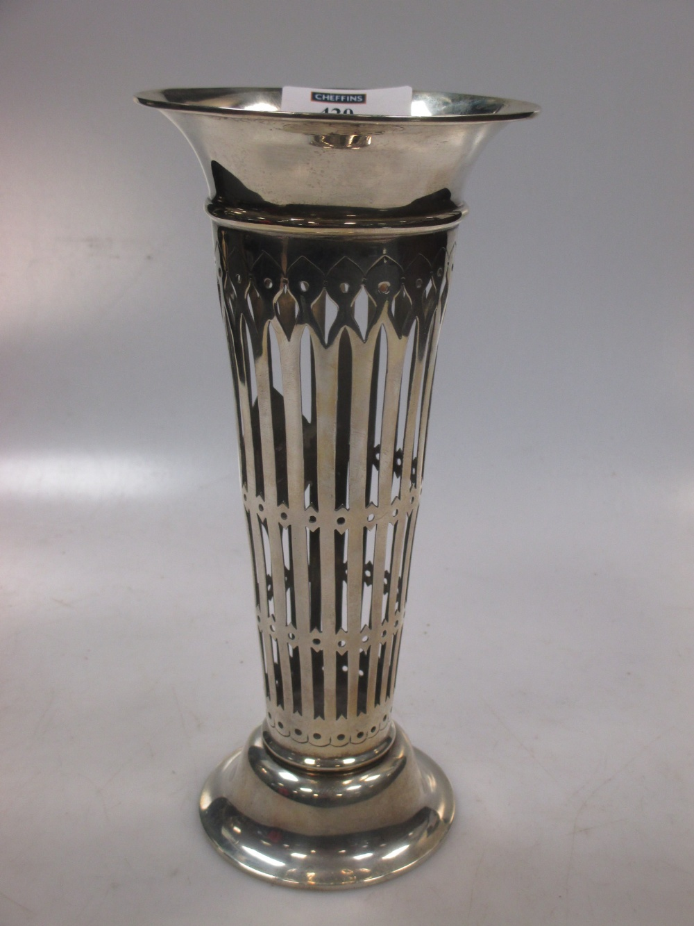 An Edward VII silver trumpet vase with pierced decoration, by, London, 1907