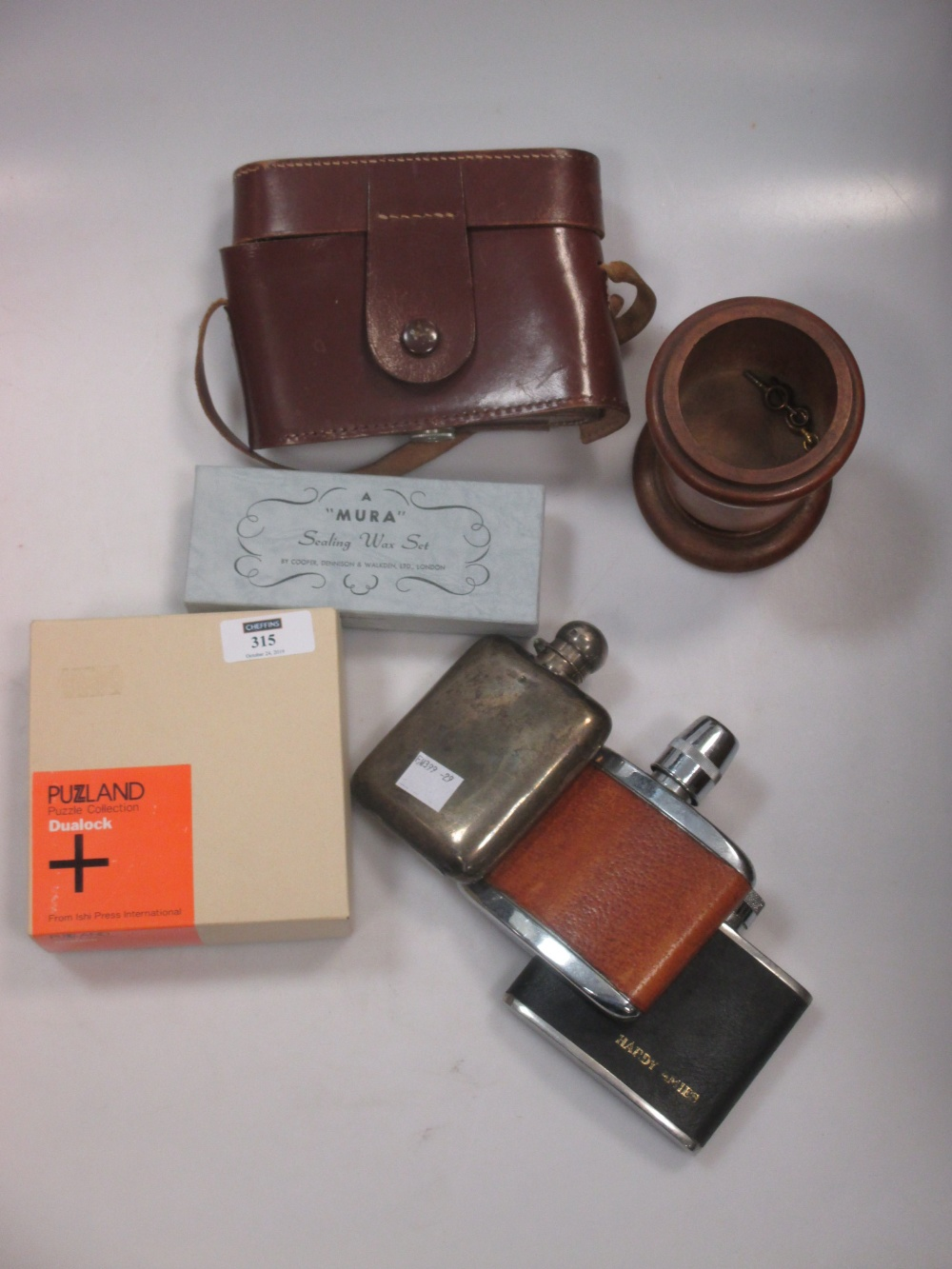 Lot 315 - A Silver hip flask (worn) 3.15ozt, 2 other flasks, camera and treen pot etc