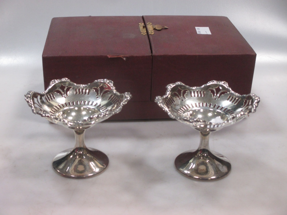 Lot 394 - A pair of monarch silver salts/bon-bon pedestal dishes (boxed); a pair of panelled clear glass