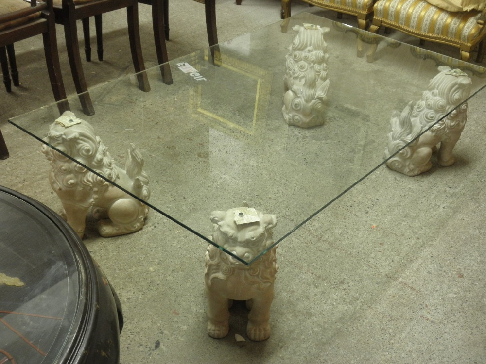 Lot 246 - 20thC glass-top coffee table with composite Chinese lion-dog legs - 20thC Glass-top Coffee Table With Composite Chinese Lion-dog Legs