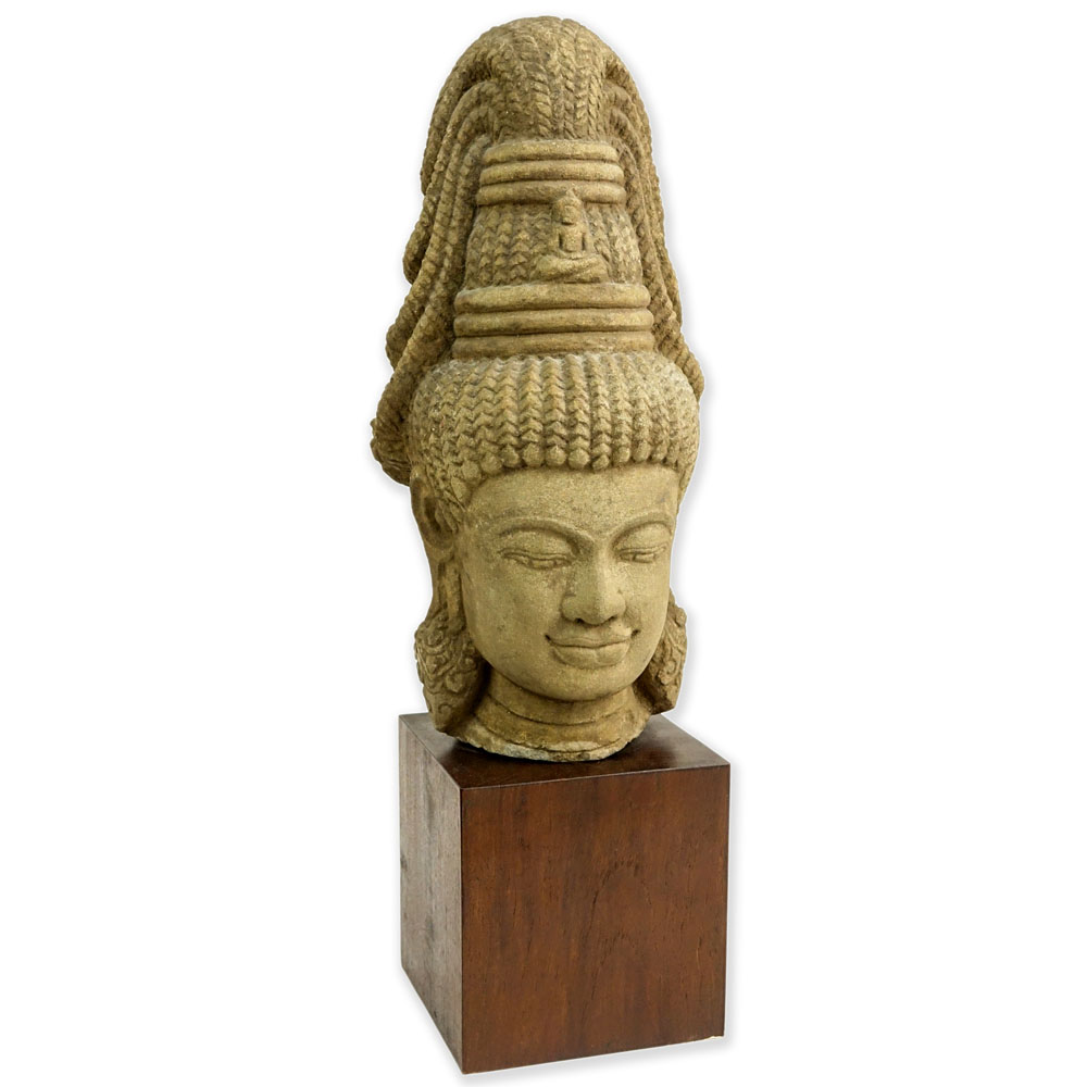Lot 164 - Vintage Cambodian Carved Stone Buddha Head. On wood block. Unsigned. Good condition. Measures 19-1/