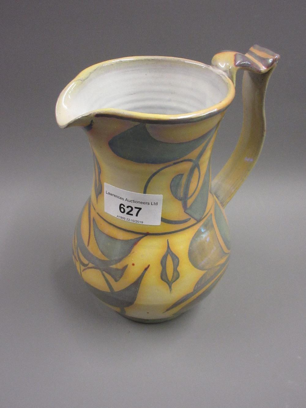 Lot 627 - Alan Caiger-Smith for Aldermaston Pottery, lustre glazed baluster form jug with a stylised floral