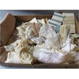 Box containing a quantity of various hand made and machine made lace