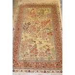 Turkish silk rug decorated with birds in a landscape, approximately 60ins x 36ins Some losses to