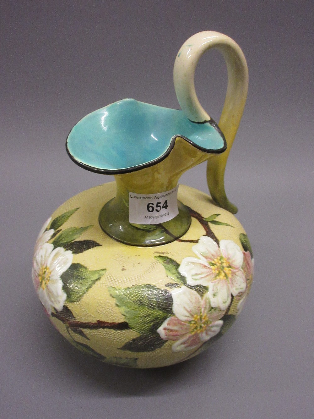 Lot 654 - Doulton Slaters Patent jug vase painted with wild flowers and coloured enamels on a yellow mottled