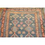 Persian runner of geometric design with multiple borders on blue ground, 120ins x 45ins